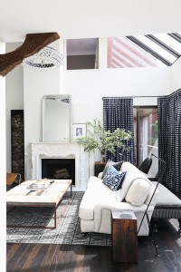 catherine kwong house dark timber floorboards white walls checked black and white living room